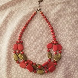 Red bead necklace with gold accent beads